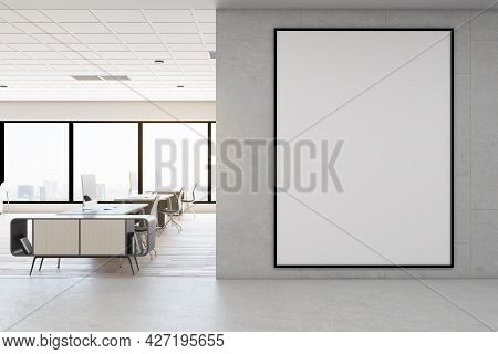 Modern Concrete Coworking Office Interior With Daylight, Empty Banner On Wall, Furniture And Equipme
