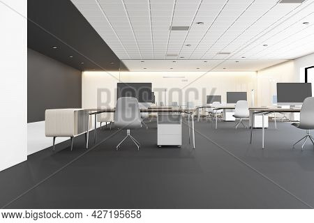 Contemporary Concrete Coworking Office Interior With Furniture, Devices And Daylight. Corporate Work