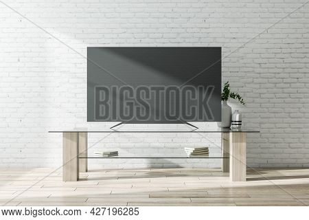 Black Tv Screen With Furniture On Brick Wall Background. Television Concept. Mock Up, 3d Rendering