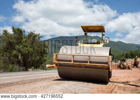 Roller Rolling Fresh Hot Asphalt On The New Road. Road Construction. The Road Rollers Working On The
