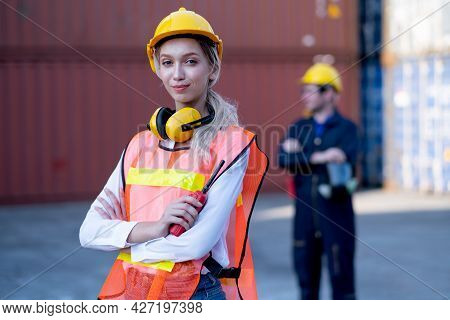 Foreman Woman Worker Stand With Confidence By Arm-crossed And Look At Camera With His Cargo Containe