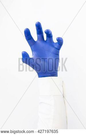 Hand In Blue Latex Glove Grabing. Copy Space, White Background