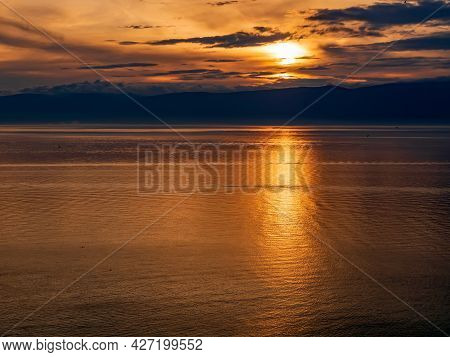 Sunset On Baikal Lake At Olkhon Island. Lake Baikal Is The Most Largest Freshwater Lake In The Plane