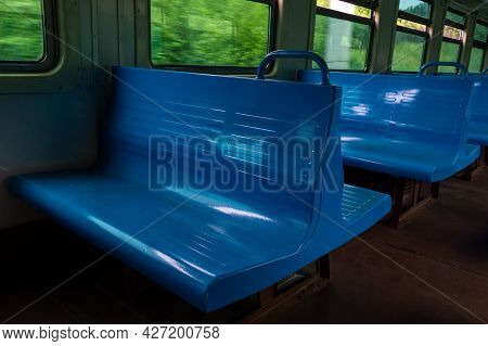 Empty Blue Seats In A Commuter Train Car. Empty Electric Train Car In Russia. Focus On Foreground