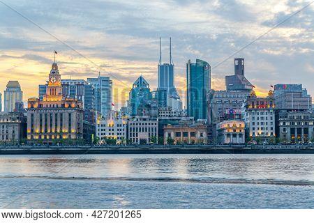 Shanghai, China - April 10, 2014: The Bund waterfront in Shanghai city at dusk