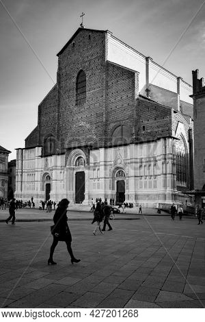 Bologna,  Italy - October 12, 2016: Rushing people by Basilica of San Petronio on Piazza Maggiore in Bologna city. Cityscape, black and white urban photography