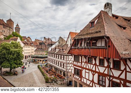 Nuremberg, Germany - May 17, 2016:  Square in the old town of Nuremberg near Kaiserburg Imperial Castle. Landmark of the city, cityscape
