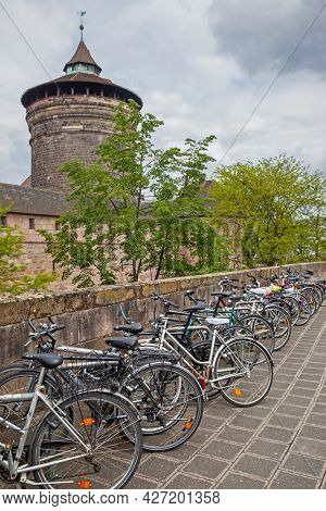 Nuremberg, Germany - May 17, 2016:  Street in the city walls of Nuremberg with parked bicycles
