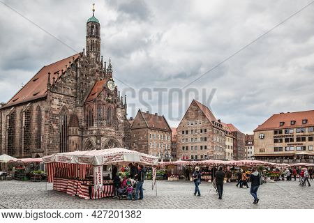Nuremberg, Germany - May 17, 2016:  Frauenkirche church and Main Market Square in Nuermberg
