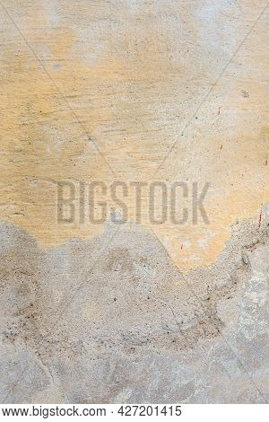 Textured Grunge Background. Old Plastered Wall With A Multilayer Cracked Coating. Grunge Texture Wit