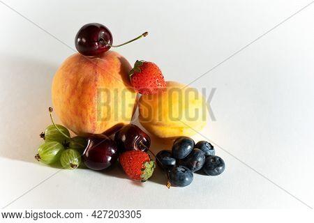 Peach, Apricot, Cherry, Gooseberry, Strawberry, Blueberry, Several Ripe Berries, Close-up, Horizonta