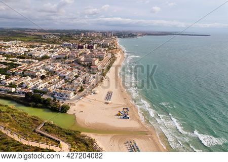 Aerial Drone Point Of View Sandy Beach Of Mil Palmeras, Mediterranean Sea In The Early Morning. Cost