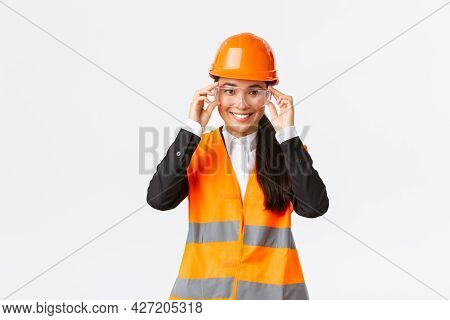 Smiling Pretty Female Asian Engineer, Construction Manager In Safety Helmet And Glasses Following Pr
