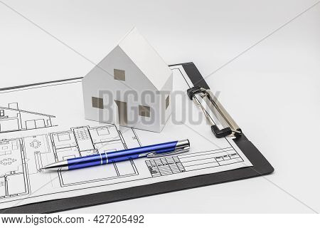 Purchase And Sale Of Housing. Mortgage For The Purchase Of A House. Rental Property. A Mock-up Of A
