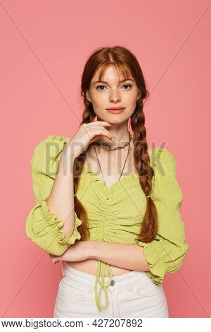 Stylish Woman With Freckles Looking At Camera Isolated On Pink