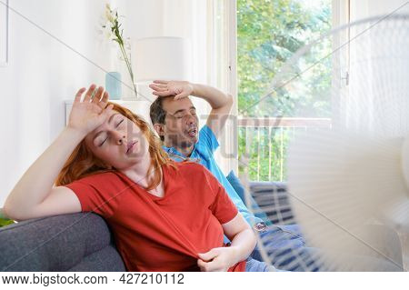 Couple Sweating And Feeling Bad For Hot Weather