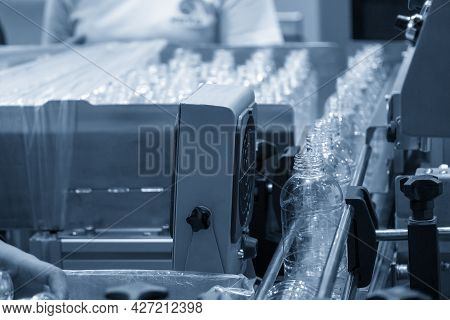 The Empty Pet Bottles  On The Conveyor Belt For Filling Process In The Drinking Water Factory. The H