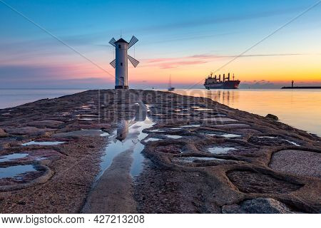 Baltic Sea And Stawa Mlyny, Navigation Beacon In Shape Of Windmill At Sunset, Official Symbol Of Swi