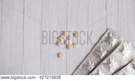 Medicine On Wooden White Table Background. Top View With Copy Space.
