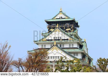 Osaka castle, Japanese ancient castle in Osaka, Japan. UNESCO world heritage site. On blue sky background