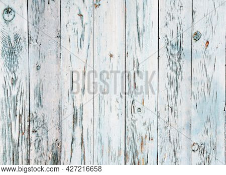 Texture of vintage wood boards with cracked paint of white and blue color. Horizontal retro background with old wooden planks