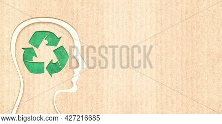 Arrows recycle symbol and human heads in paper cut style. Horizontal banner with eco paper texture. Paper cardboard background. Recycled carton material. Copy space for text. Mock up template