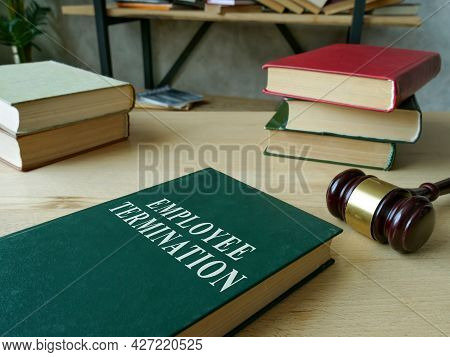 Employee Termination Rules Book And Wooden Gavel.