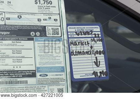 Plainfield - Circa July 2021: Ford Car And Suv Sticker Price With A Market Demand Increase In Price.