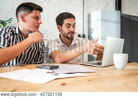 Gay Couple Paying Their Bills Online With