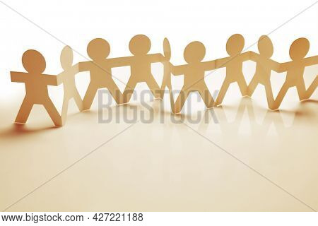 Paper chain team holding hands. Teamwork. Partnership