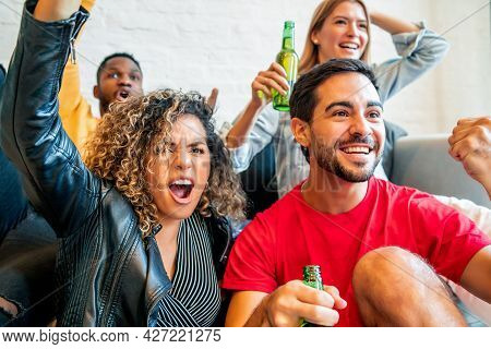 Friends Having Good Time While Watching A