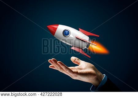 Rocket Growth Concept. Symbol Of Fast Growth - Hand With Holding Gesture And Cartoon Rocket Flying A
