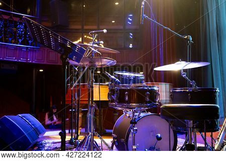 Shot Showing Drum Kit With Multiple Drums Cymbals Snares Bass And More Placed On A Stage Ready For A