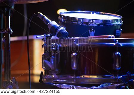 Close Up Shot Showing Drum Kit With Multiple Drums Cymbals Snares Bass And More Placed On A Stage Re