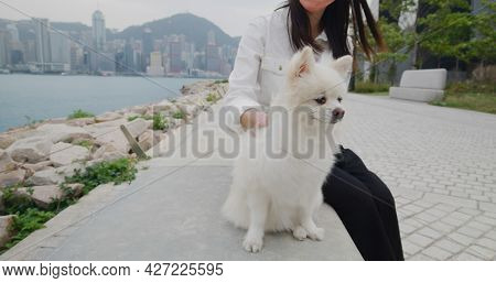 Woman go out with her dog
