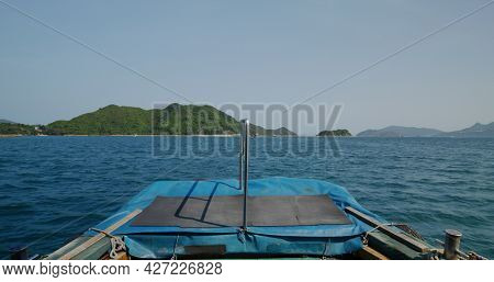 Take boat to the island