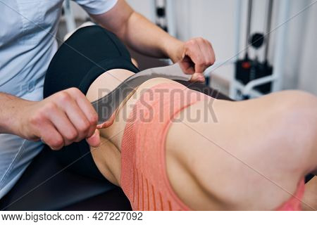 Male Chiropractor Is Treating Woman Abdominal Muscles