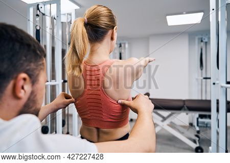 Male Chiropractor Reabilitate Woman Posture And Spine After Injury Closeup. Scoliosis. Sport Trauma