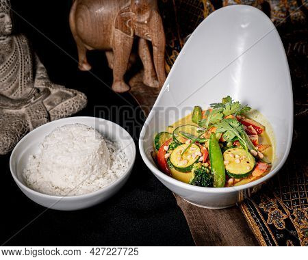 Exquisite Curry With Zucchini, Broccoli, Broccoli, Basil With A Soy Sauce And Mushrooms Accompanied