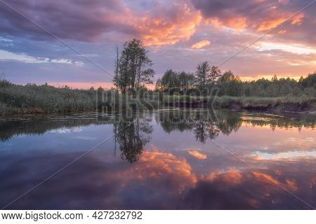 Summer Scenery Of The River And Forest. Scenic Sunrise Over The River. Reflection Clouds In The Rive