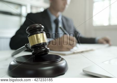 Law, Legal Services, Advice, Justice And Law Concept. Male Lawyer In The Office With Brass Scale.