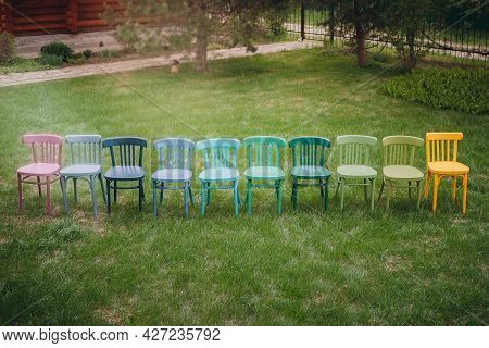 Top View Of A Row Of Colorful Viennese Chairs In A Row, A Childrens Birthday Party In The Garden On