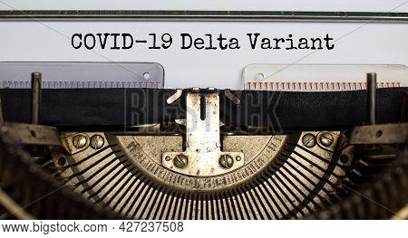 Covid-19 Delta Virus Variant Symbol. Words 'covid-19 Delta Variant' Typed On Retro Typewriter. Medic