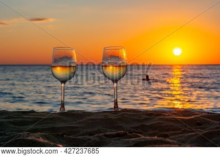Two Glasses Of Wine On A Beach At Sunset, Sicily Island, Italy