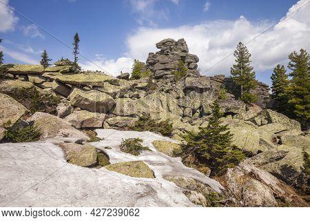 Remnants Pillars On Mount Zelenaya. Sheregesh, Russia