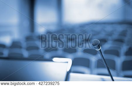 Rostrum With Microphone And Computer In Conference Hall, Blue Toned