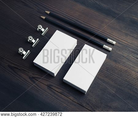 Blank Business Stationery On Wooden Background. Blank Business Cards, Pencils And Paper Clips.