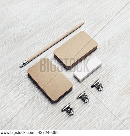 Blank Stationery Set. Kraft Business Cards, Pencil And Eraser On Light Wooden Background. Branding I