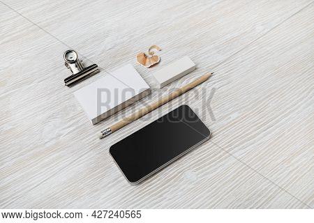 Blank Branding Mockup. Blank Business Cards, Smartphone, Pencil And Eraser On Light Wood Table Backg