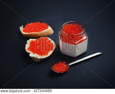 Still Life With Red Caviar. Sandwiches With Red Caviar, Glass Jar And Spoon.
